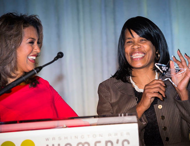 Goodwill graduate Juanita King accepts award presented by Lesli Foster from the Washington Area Womens Foundation