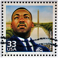 US Stamp with Martin Luther King Jr and the Washington Monument on it