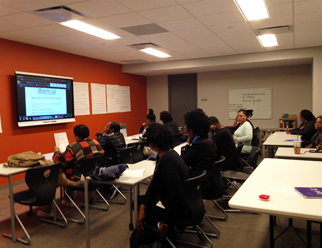 The Goodwill Excel Center Adult Public Charter School classroom with students beginning a class