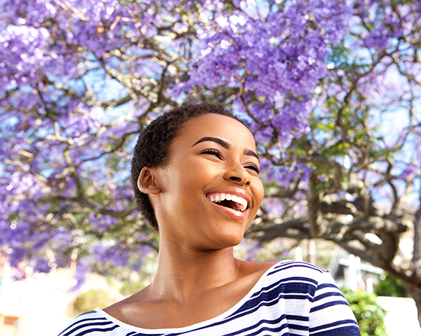 smiling african american woman cherry blossoms