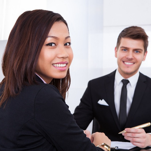 man and woman during a job interview