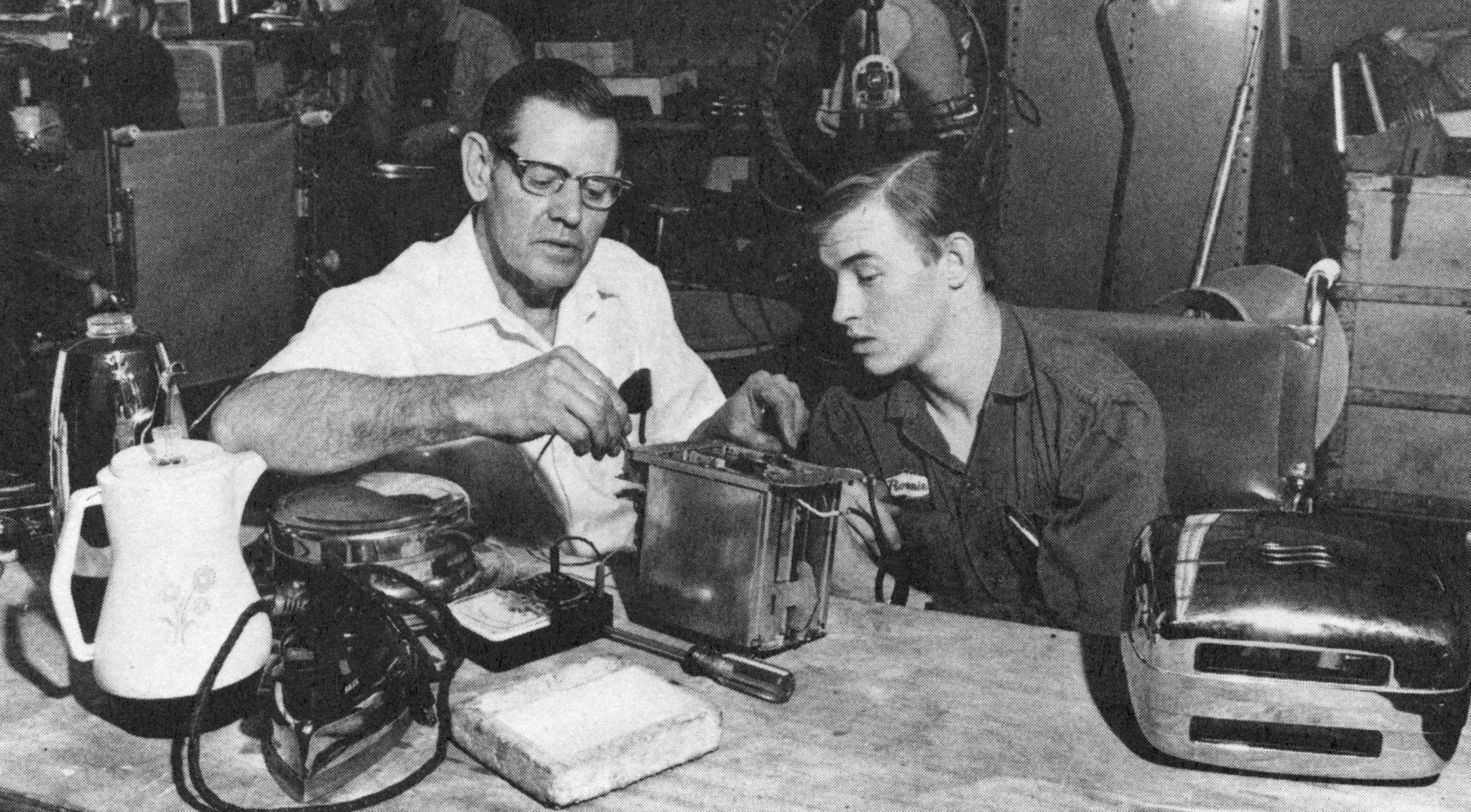 historical Goodwill photo of a young man learning to fix a toaster
