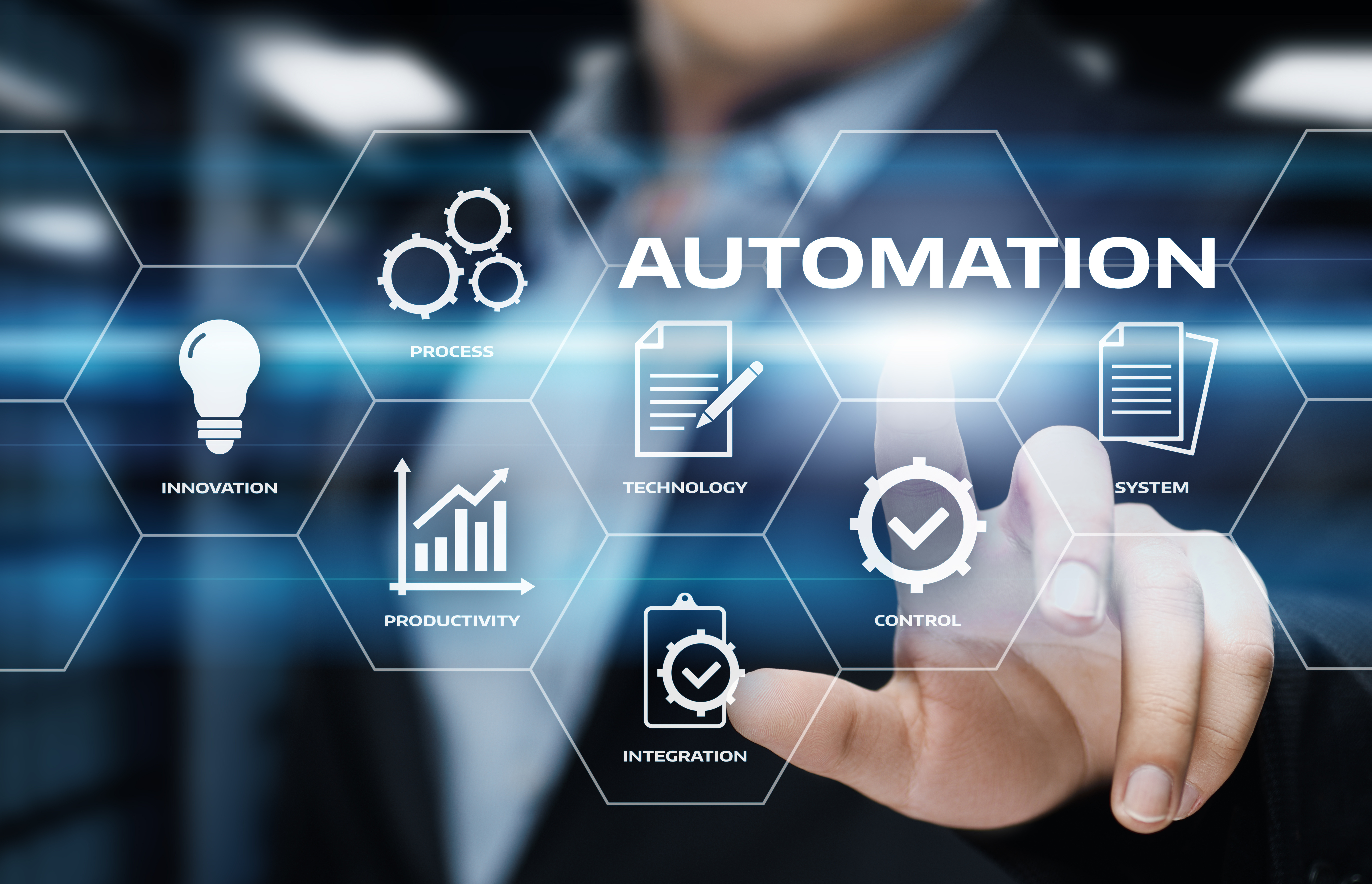 Automation stock image - man in suit uses touch screen