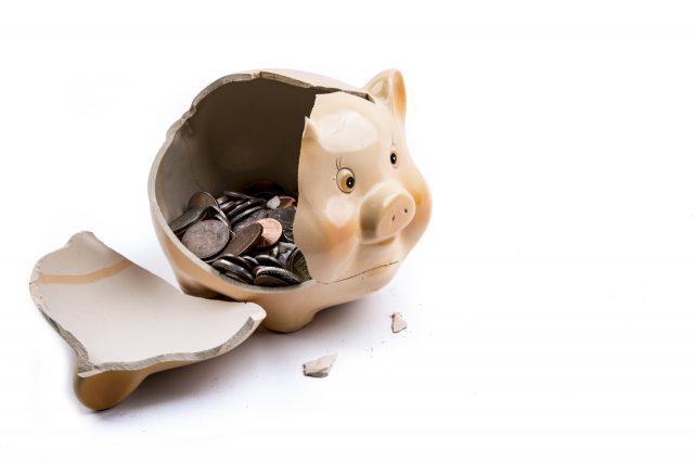 broken piggy bank with change inside