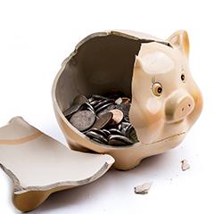 broken piggy bank with coins inside