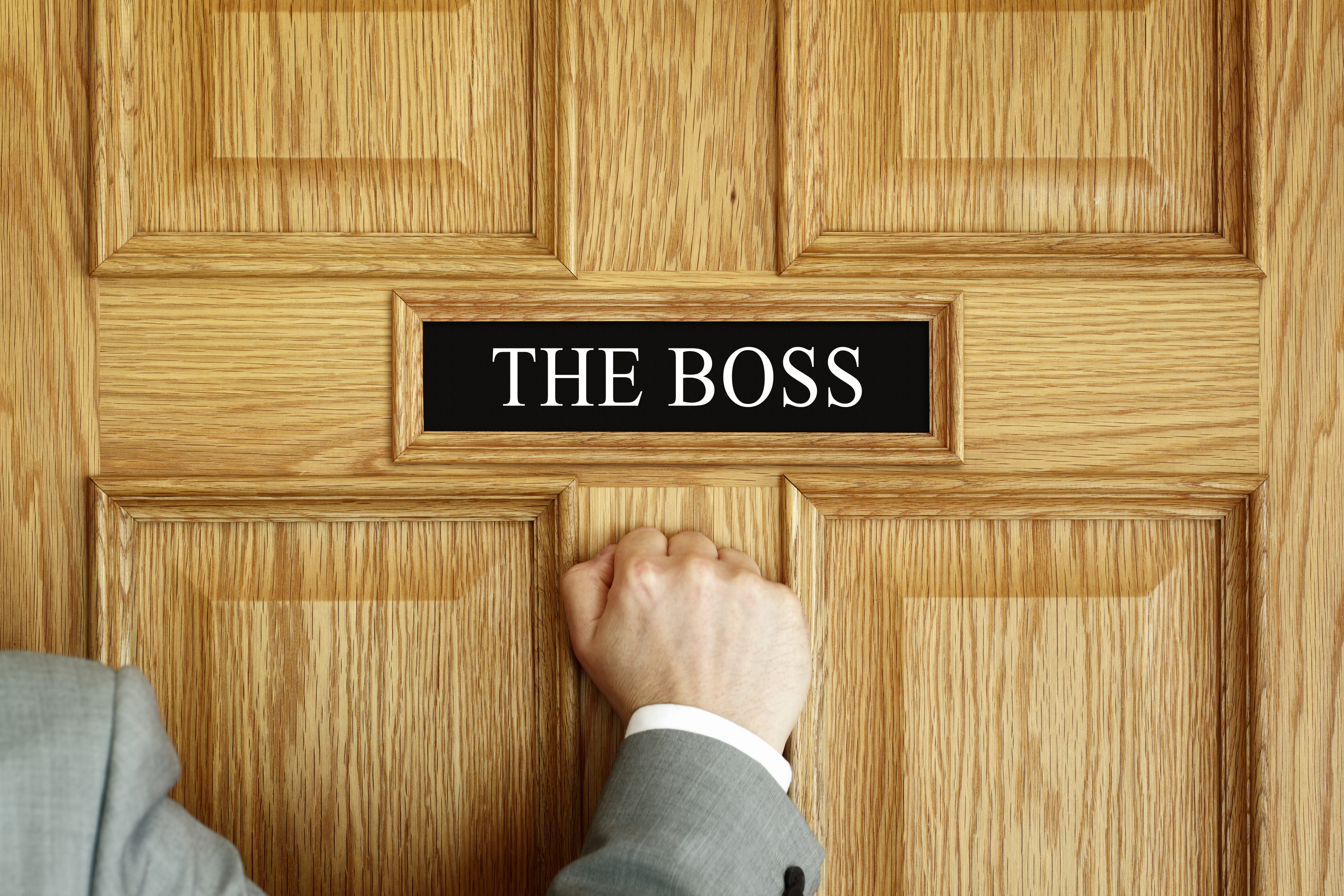 """Person knocking on a door to """"The Boss"""" office"""