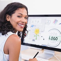 woman graphic designer sits at a computer