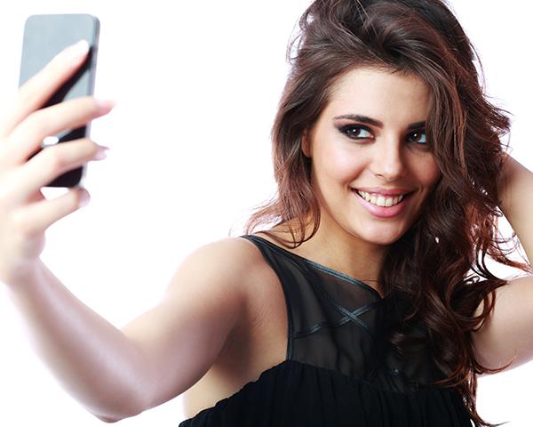 stock image of woman taking selfie