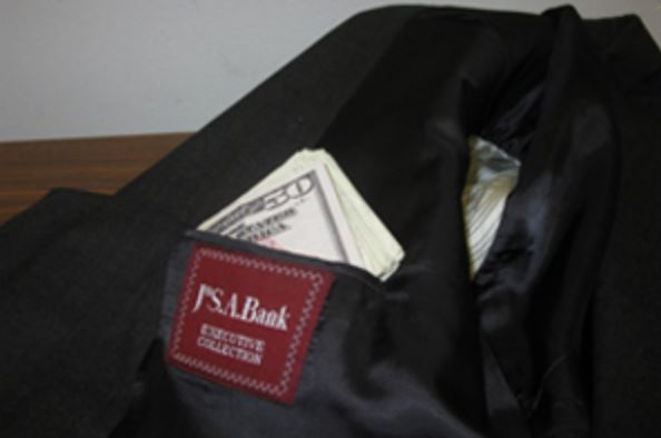 suit jacket with money in the pockets donated to Goodwill