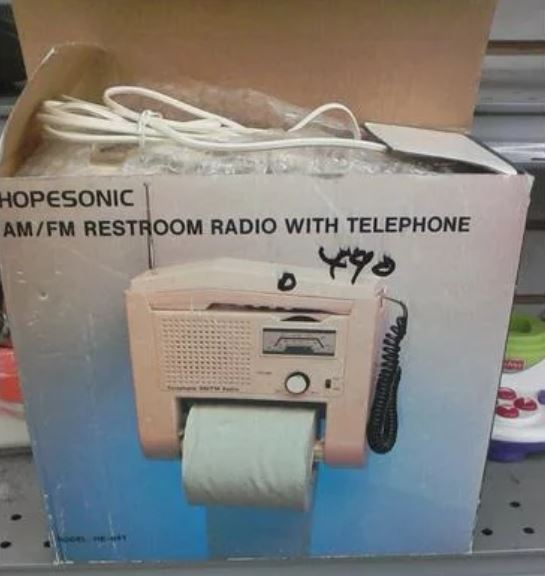 am fm radio and phone toliet paper dispenser found secondhand