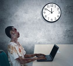 Zombie typing on laptop