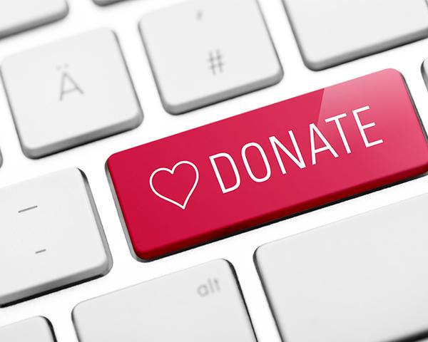 donate button keyboard stock photo