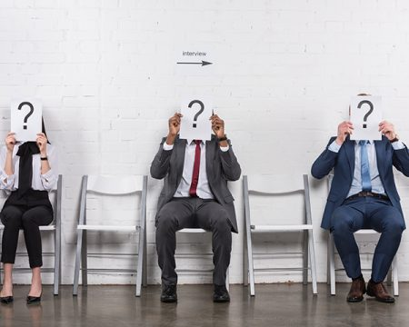 3 unidentified interview candidates sit in chairs