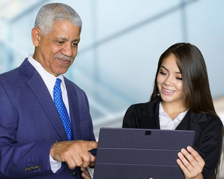 mature business man shares tablet with coworker