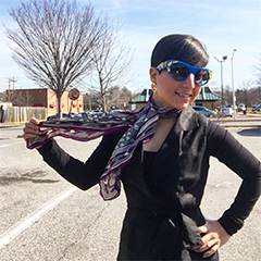 carolyn becker poses in spring time scarf and sunnies