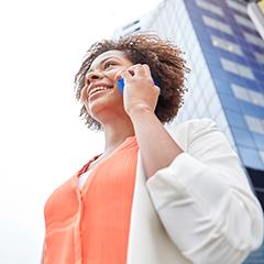 smiling woman talks on phone