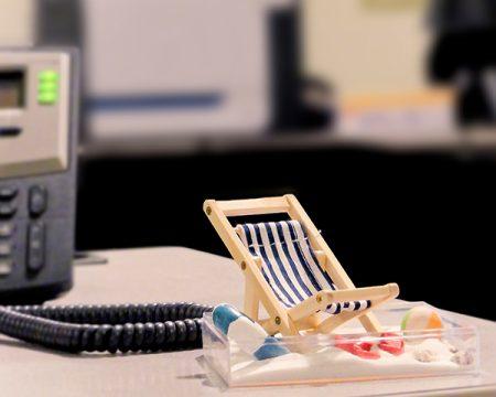 mini beach chair in sandbox on desk