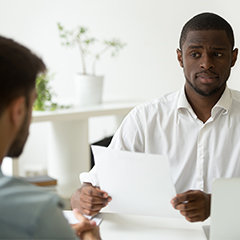 apprehensive african american man supervisor screens interview candidate